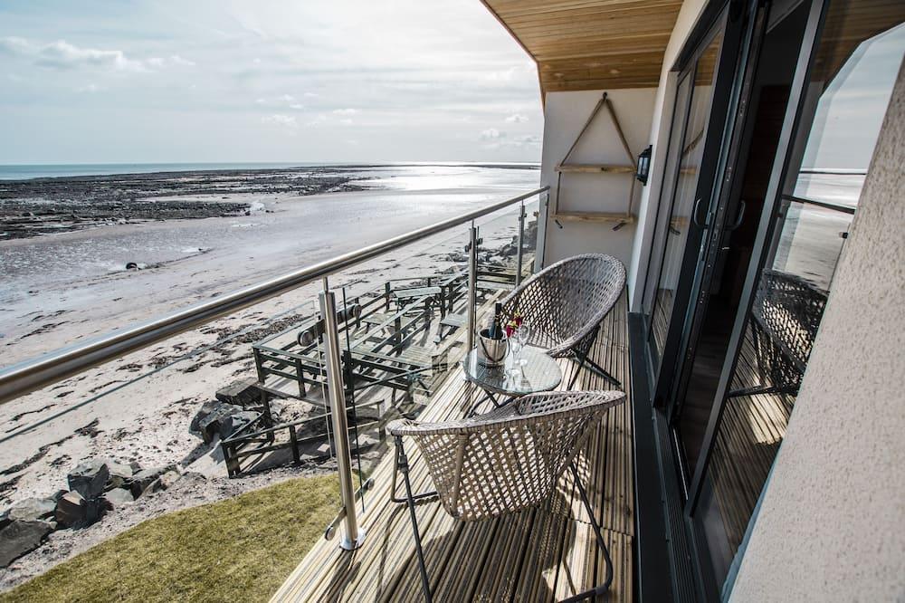 Suite Deluks, ensuite, pemandangan laut (Captains Cove) - Pemandangan Balkon