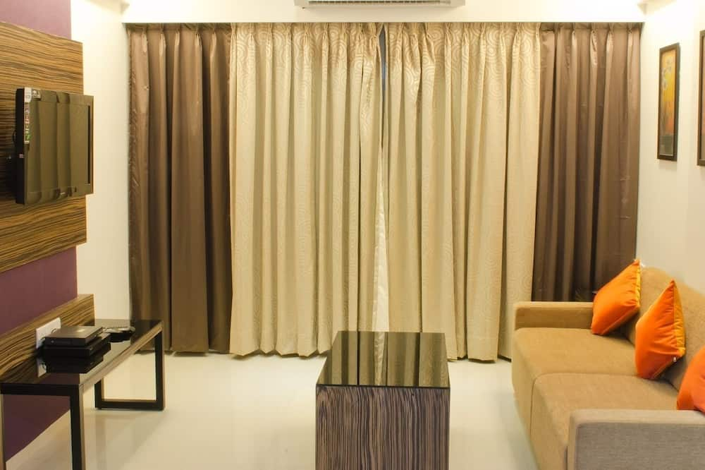Suite ejecutiva, 1 habitación, cocina básica - Sala de estar