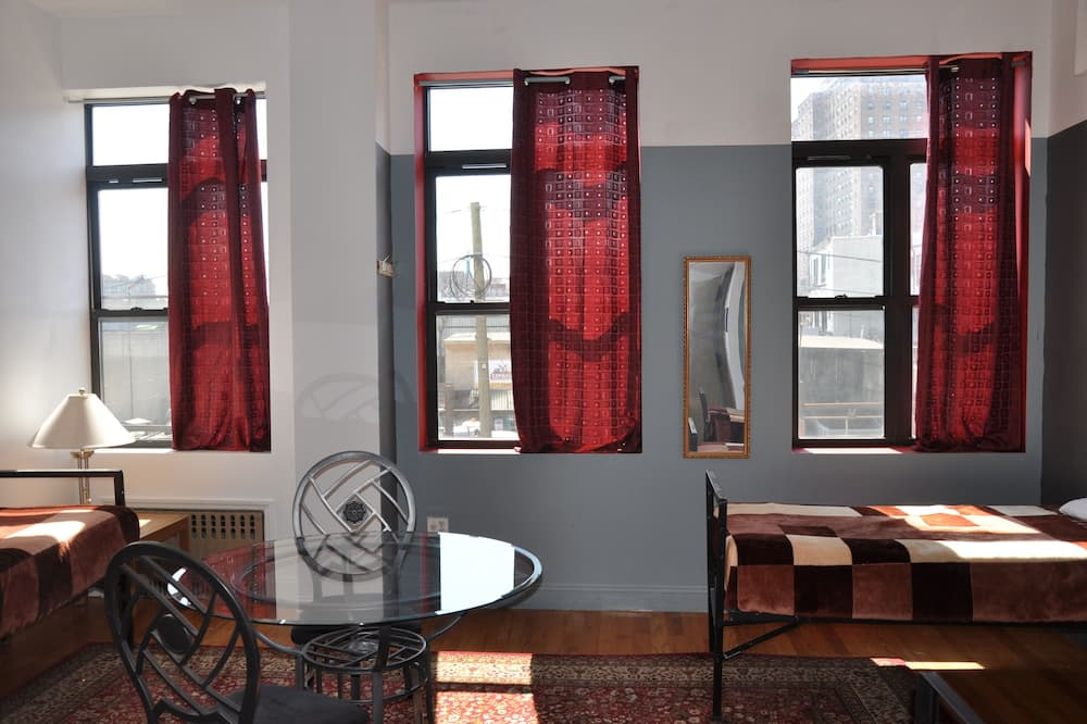 Single Bed in Shared Dormitory (women only),  Private Bathroom (4 person max) - Living Area