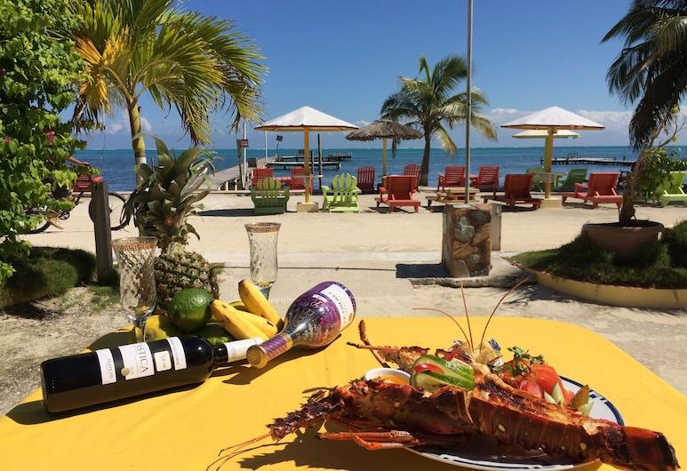 Tropical Paradise Hotel, Caye Caulker, Speisen im Freien