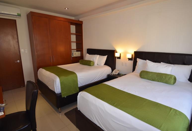 سويتس لا كونكورديا, بويبلا, غرفة ديلوكس مزدوجة, الغرفة