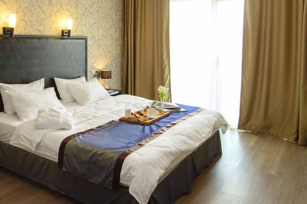 Suite, 1 Tempat Tidur King, smoking, balkon - Ruang Keluarga