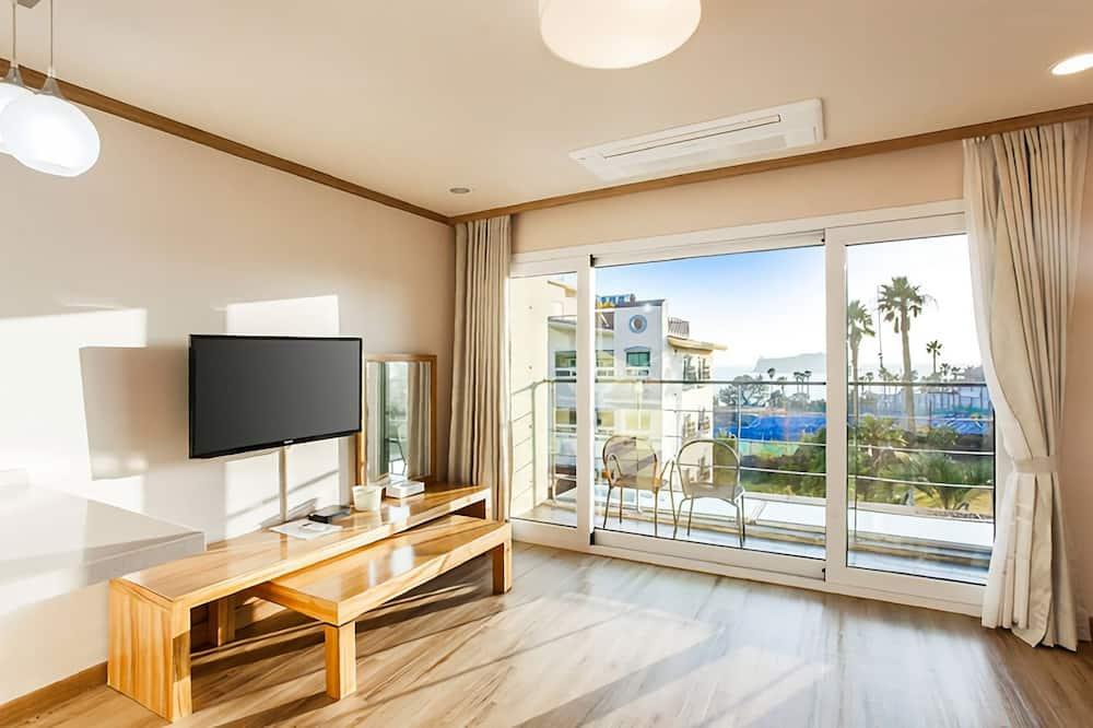 إستديو ديلوكس - غرفة نوم واحدة - لغير المدخنين - بمنظر جزئي للمحيط - غرفة نزلاء