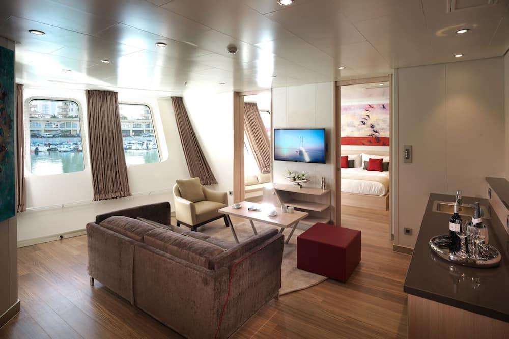 Suite Studio, 1 très grand lit - Salle de séjour