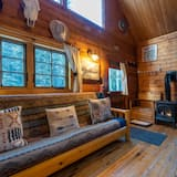 Traditionel hytte - flere senge - bjergudsigt - ved bjerg - Opholdsområde
