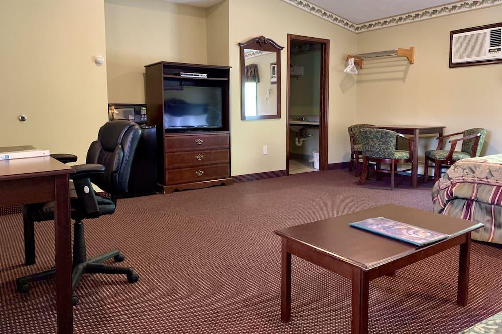Executive-Zimmer, 1King-Bett und Schlafsofa - Wohnbereich