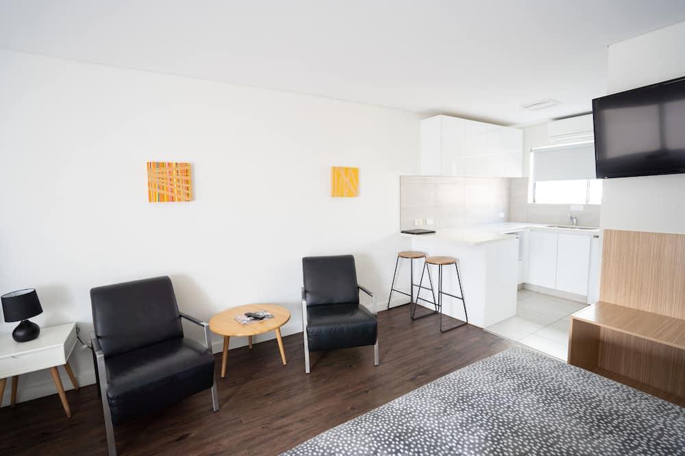 Habitación superior con 2 camas individuales - Zona de estar